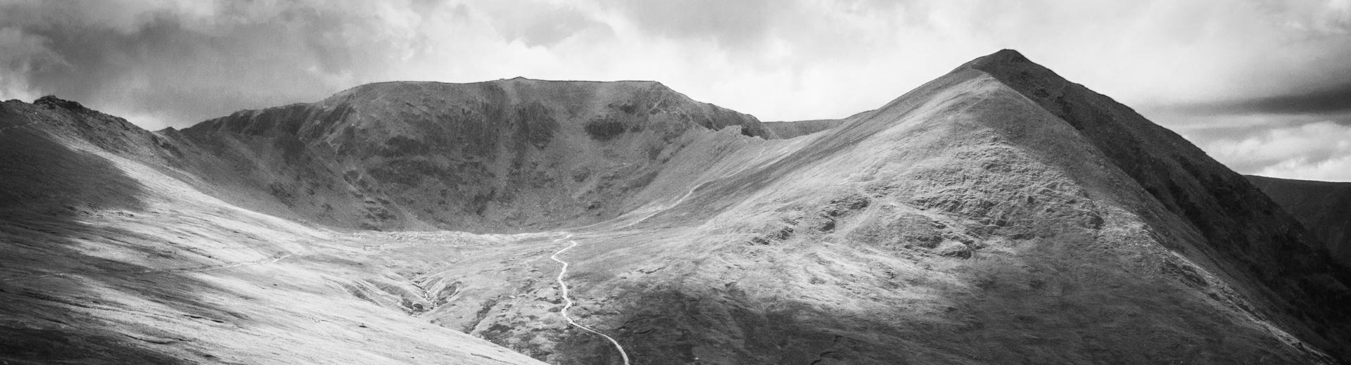 Catstye Cam or Catstycam, seen from Hole in the Wall and with Helvellyn in the background